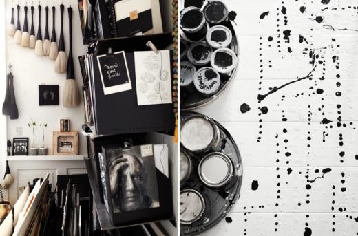 Vackra kalligrafipenslar och färgstänk på det vita ateljegolvet.